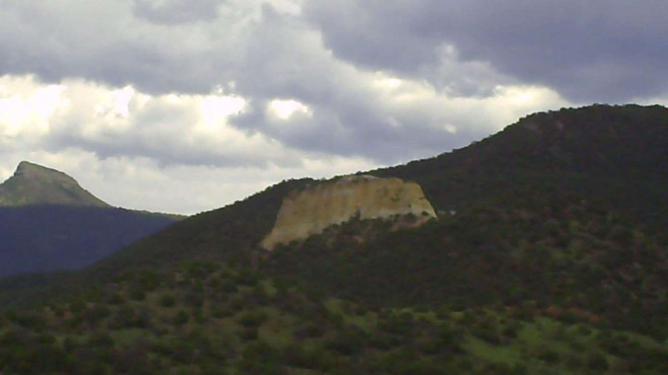 The Encino Trail climbs the forested north facing slope of the Sierra Valdez. In the foreground is Peñasco Amarillo de la Cañada (yellow rock of the vale). – Roberto Valdez