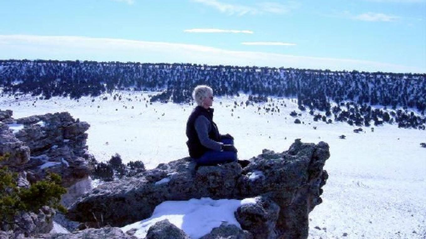Guest meditating at the top of the cliffs near the ranch house – M. Merrill