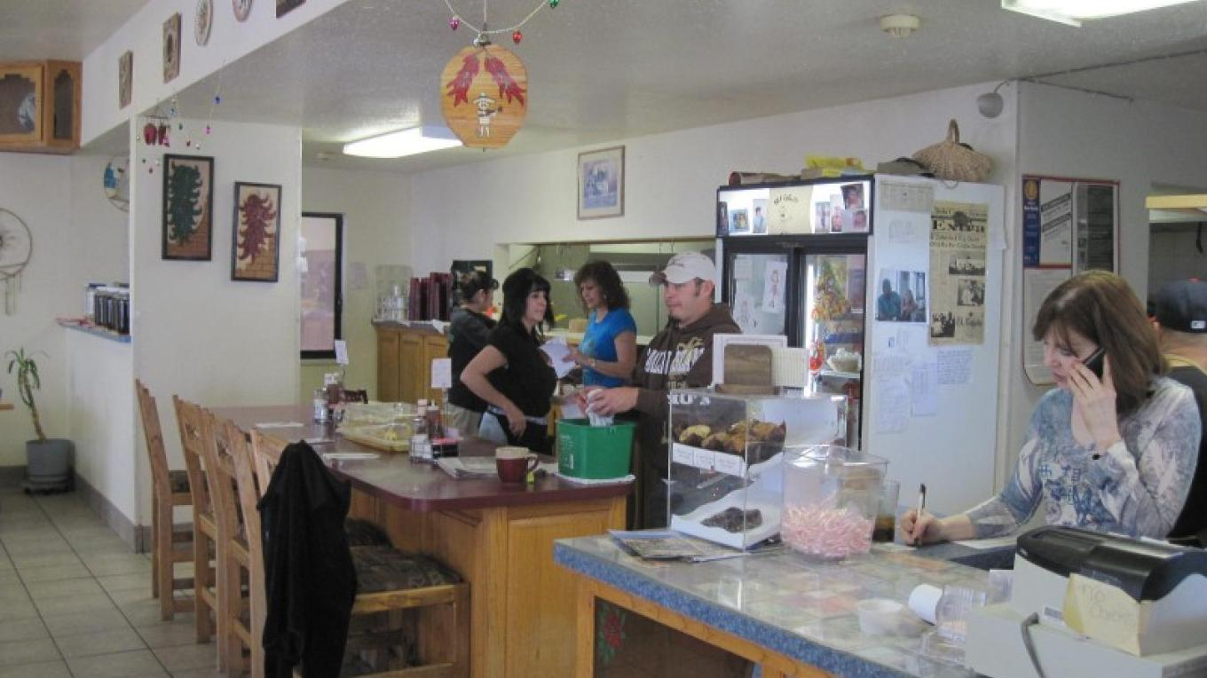 El Cafecito's friendly staff, and colorful decor of the large, open dining room. – SO