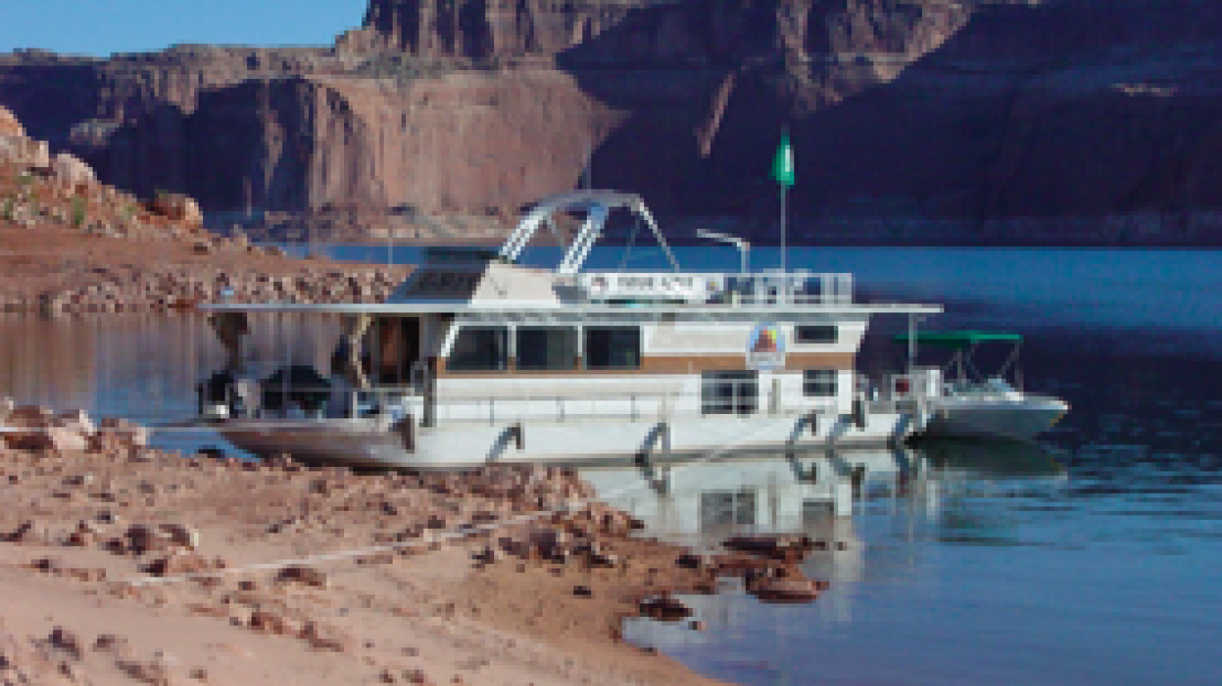 "The ""Trash Tracker"" houseboat with the ""Eliminator"" barge and small runabout. – Glen Canyon Photographer"