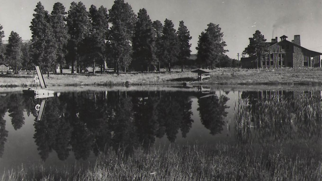Ashley Pond during the Ranch School days. Fuller Lodge is in the background. – From the Los Alamos Historical Museum Archives
