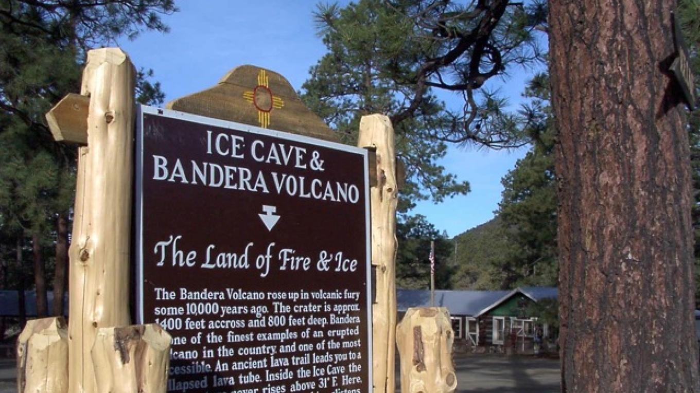New Mexico's Land of Fire and Ice - Historic Marker with historic, Ice Caves Trading Post in the background. – Jeff Alford