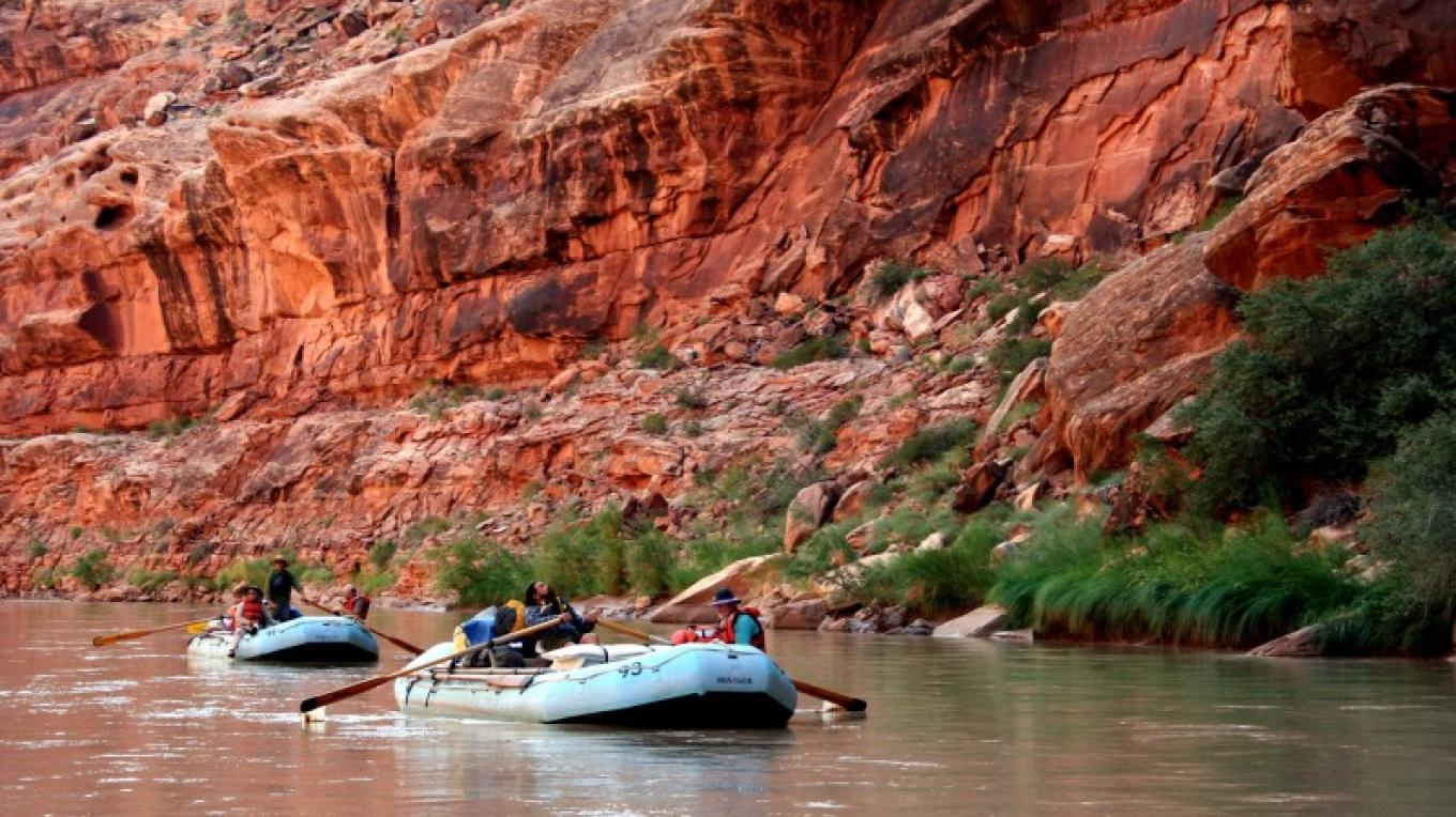 Floating in the deep canyon of the San Juan River.  River trips are available from Bluff during the summer season. – Wild Rivers Expeditions