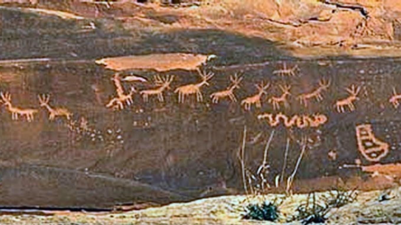 One of the many images carved on the rock face at Sand Island.