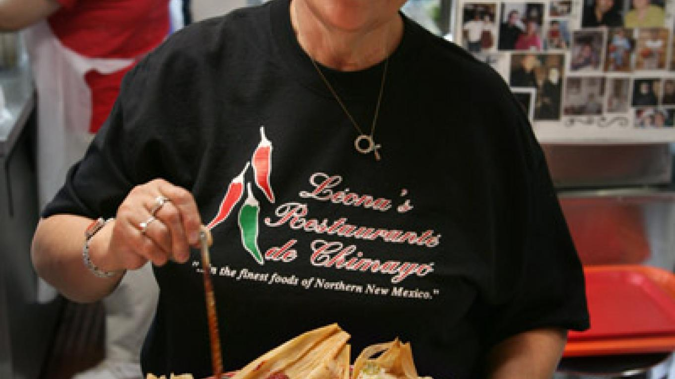 Leona Tiede serving up a plate of tamales and salsa. – Richard L. Rieckenberg