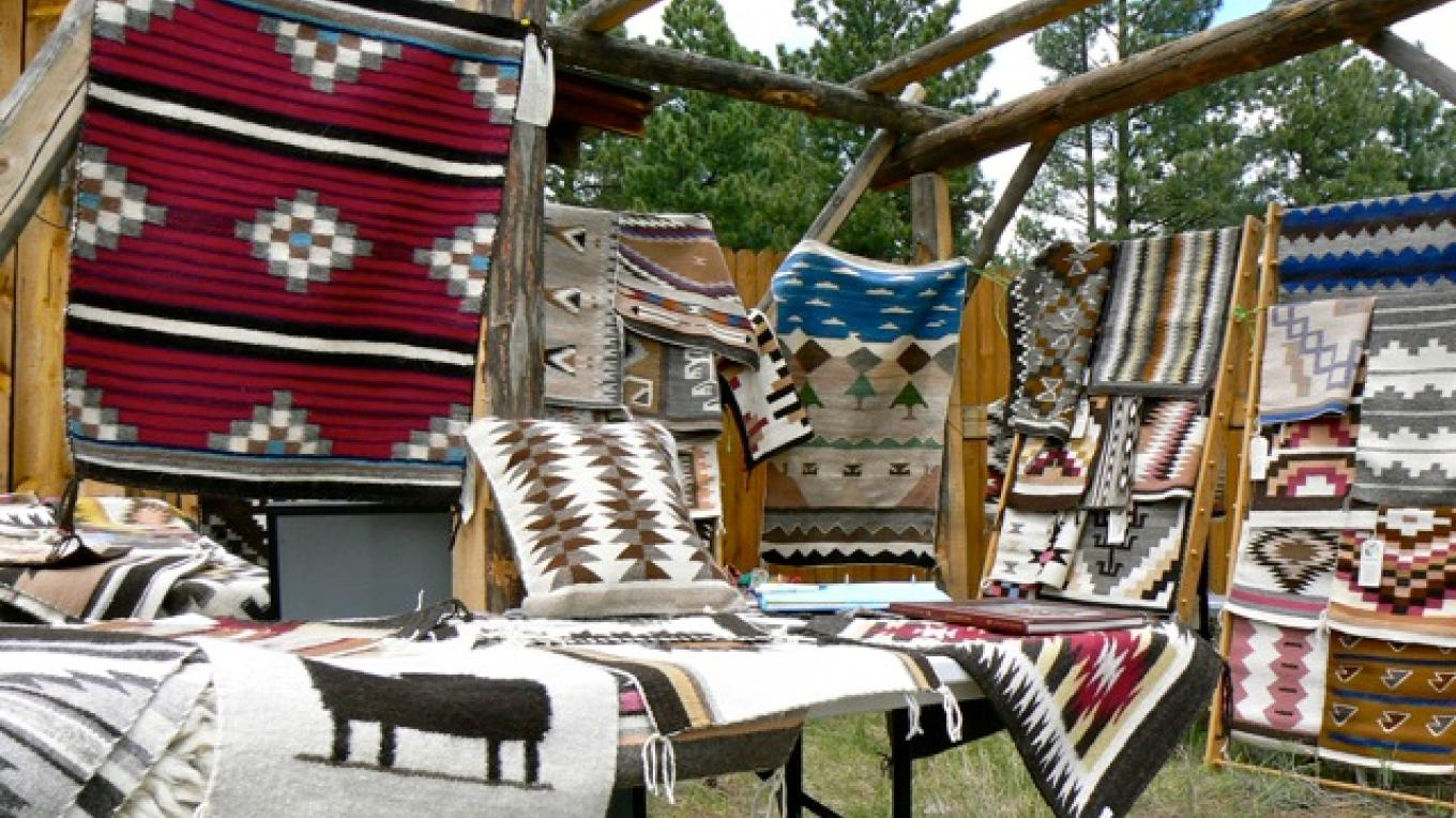 A beautiful assortment of weavings handcrafted by the Ramah Navajo Weavers Association at  the Ancient Way Arts Trail 2008 Spring Festival  at the Cimarron Rose Bed & Breakfast – Sheri McWethy Kennedy