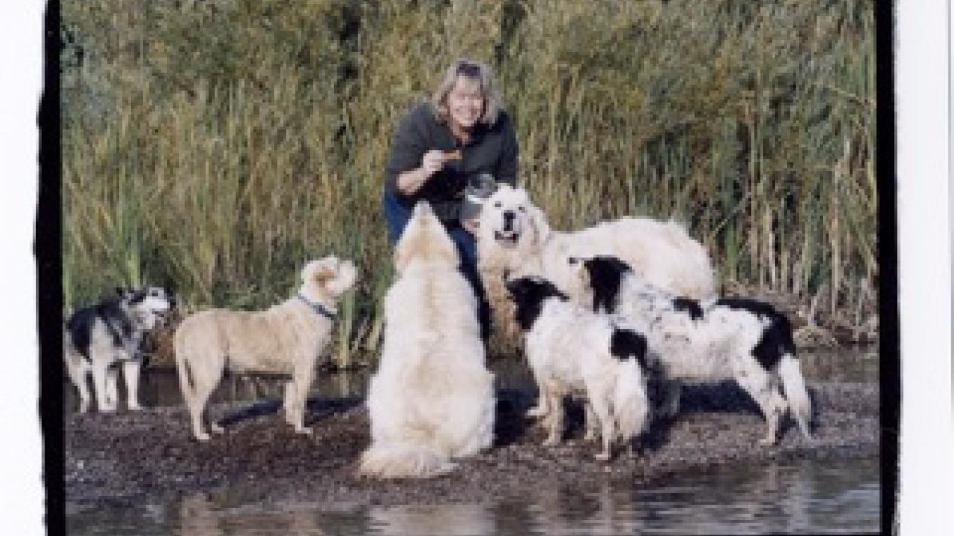 September 2004 - Lori Faye Bock taking time out with her six pack of canines at home along the Rio Chama in Abiquiu, New Mexico. – Jennifer Esperanza