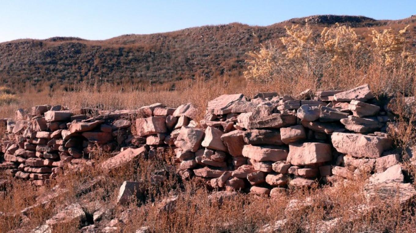 Spanish mission ruins in foreground with Hawikku ruins on the ridge. – Tom R. Kennedy