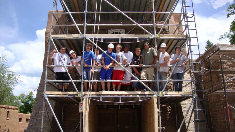St. Michael's High School football team volunteers at San Miguel Preservation efforts – Nicolas Minos