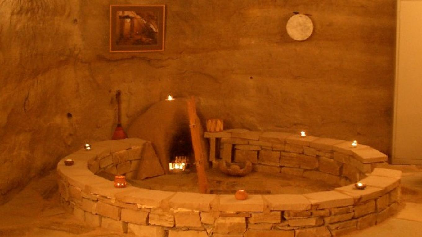 Kiva Fireplace in Kokopelli's Cave – Bruce Black