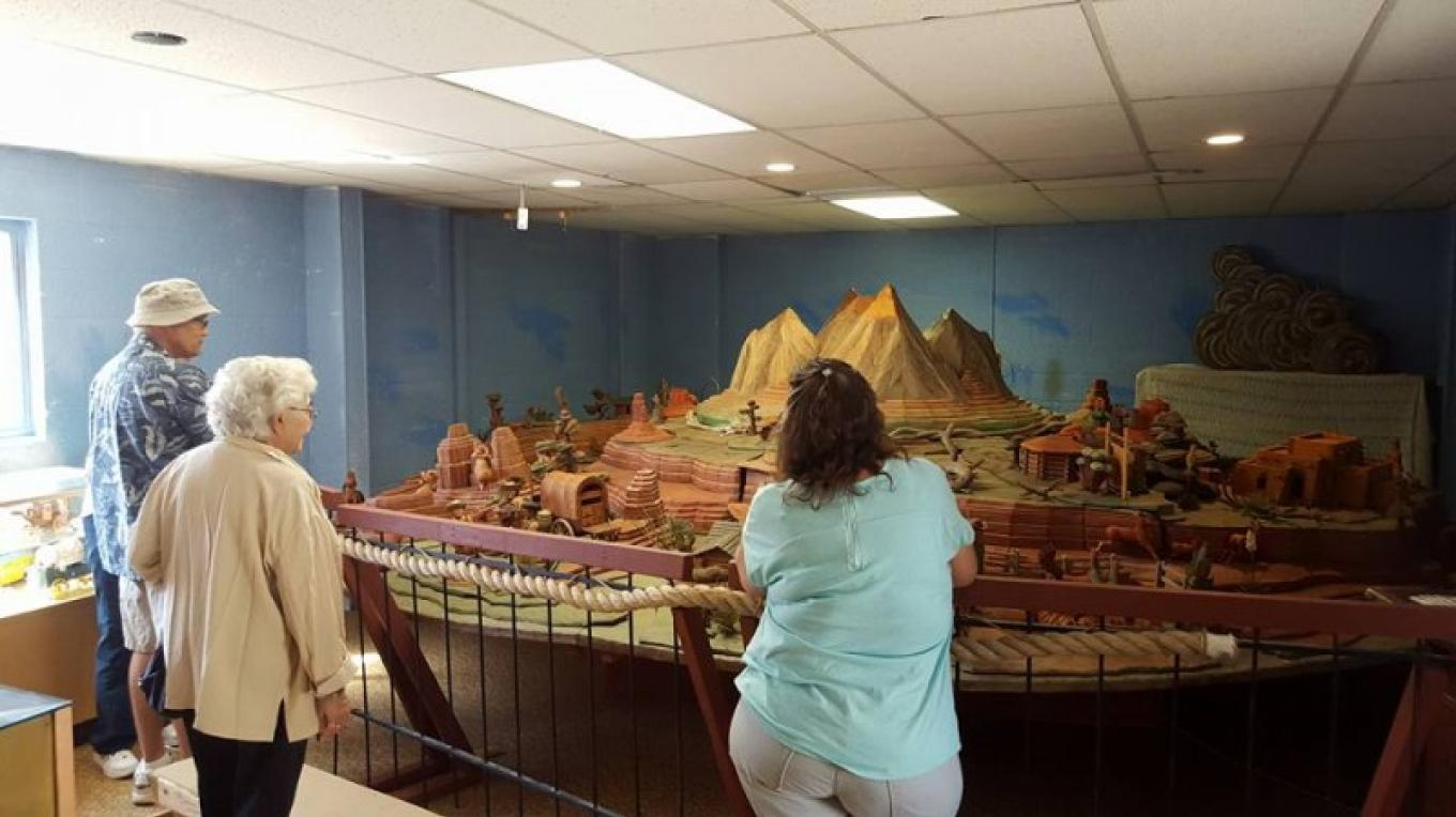 """Valenty Zaharek's """"Pecos West"""" features over 100 hand carved woodcarvings of people, animals, plants, buildings, vehicles and the high mesas and mountains of the desert Southwest. – Dale W. Anderson"""