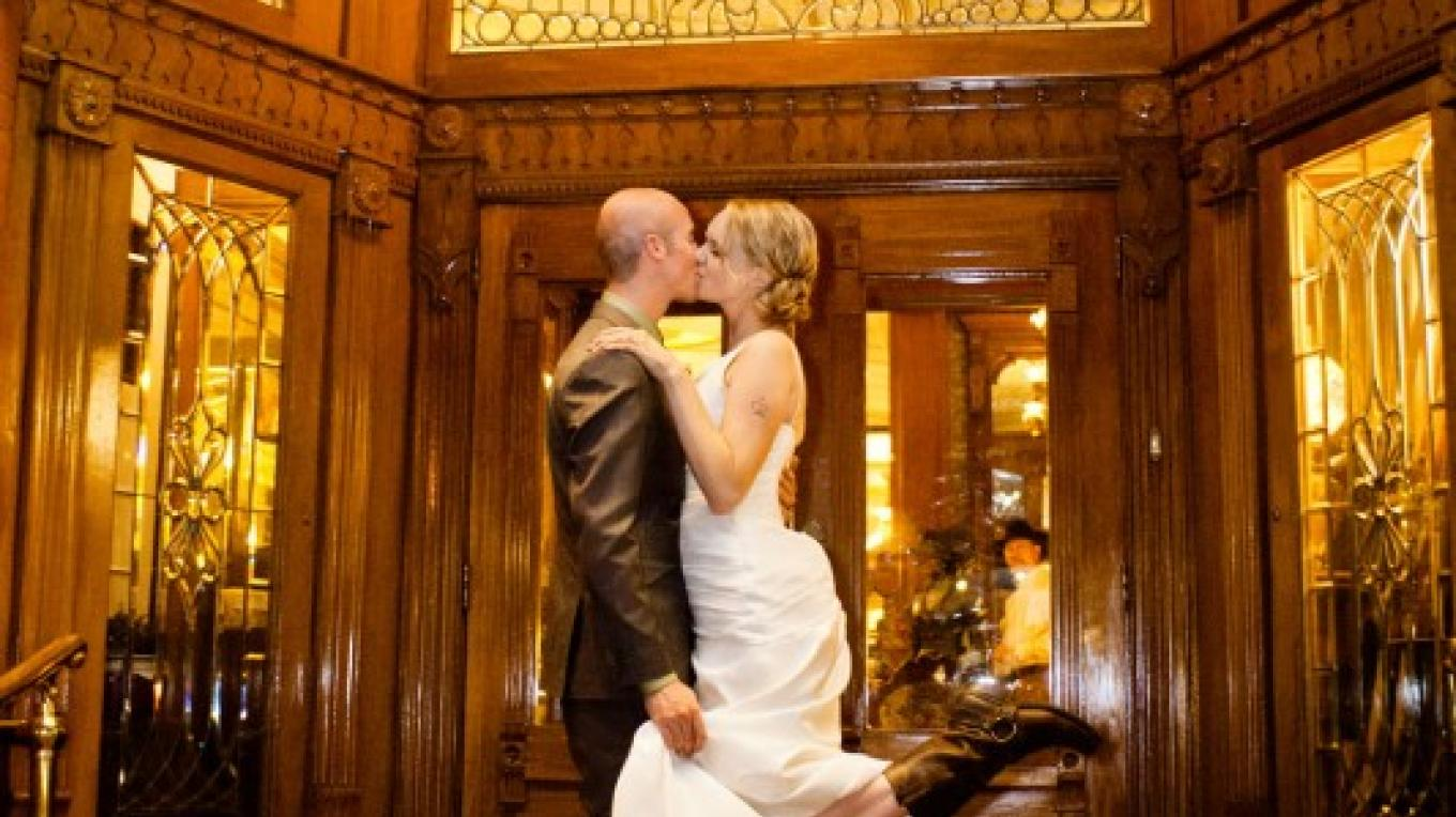 Wedding day on the front steps of the Strater Hotel. – Christina Kiffney Photography