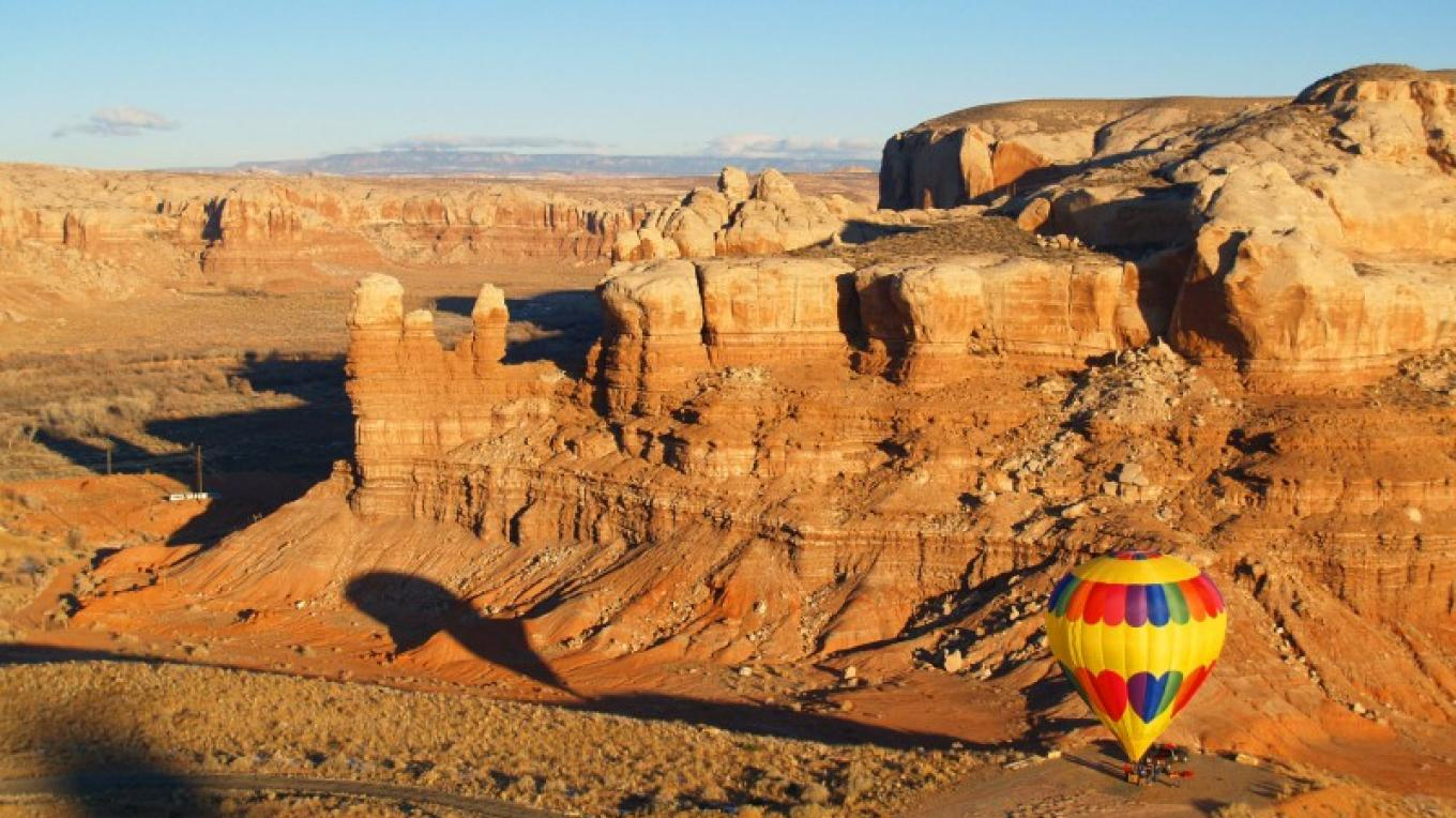 Ballooning is beautiful against the red rocks of Bluff. – Tina Finch