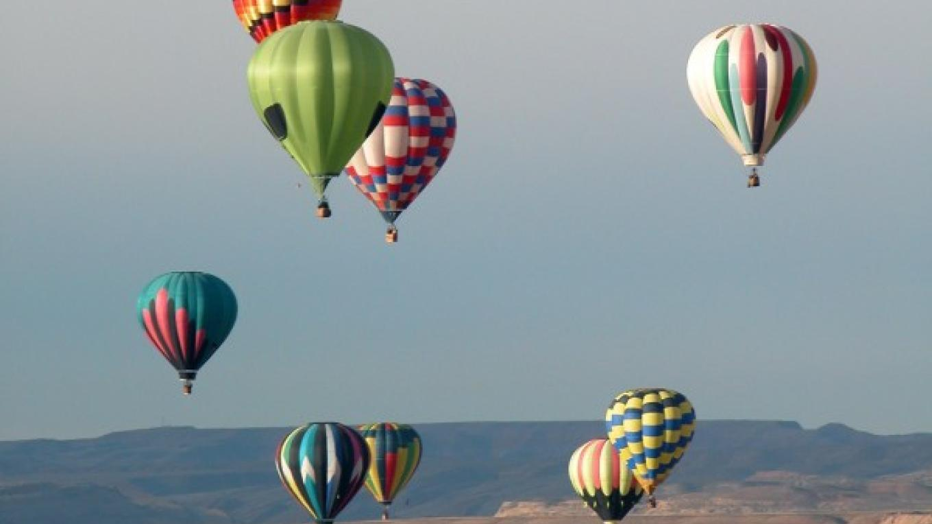 Balloons over Bluff during the annual Bluff International Balloon Festival. – Bluff, Utah
