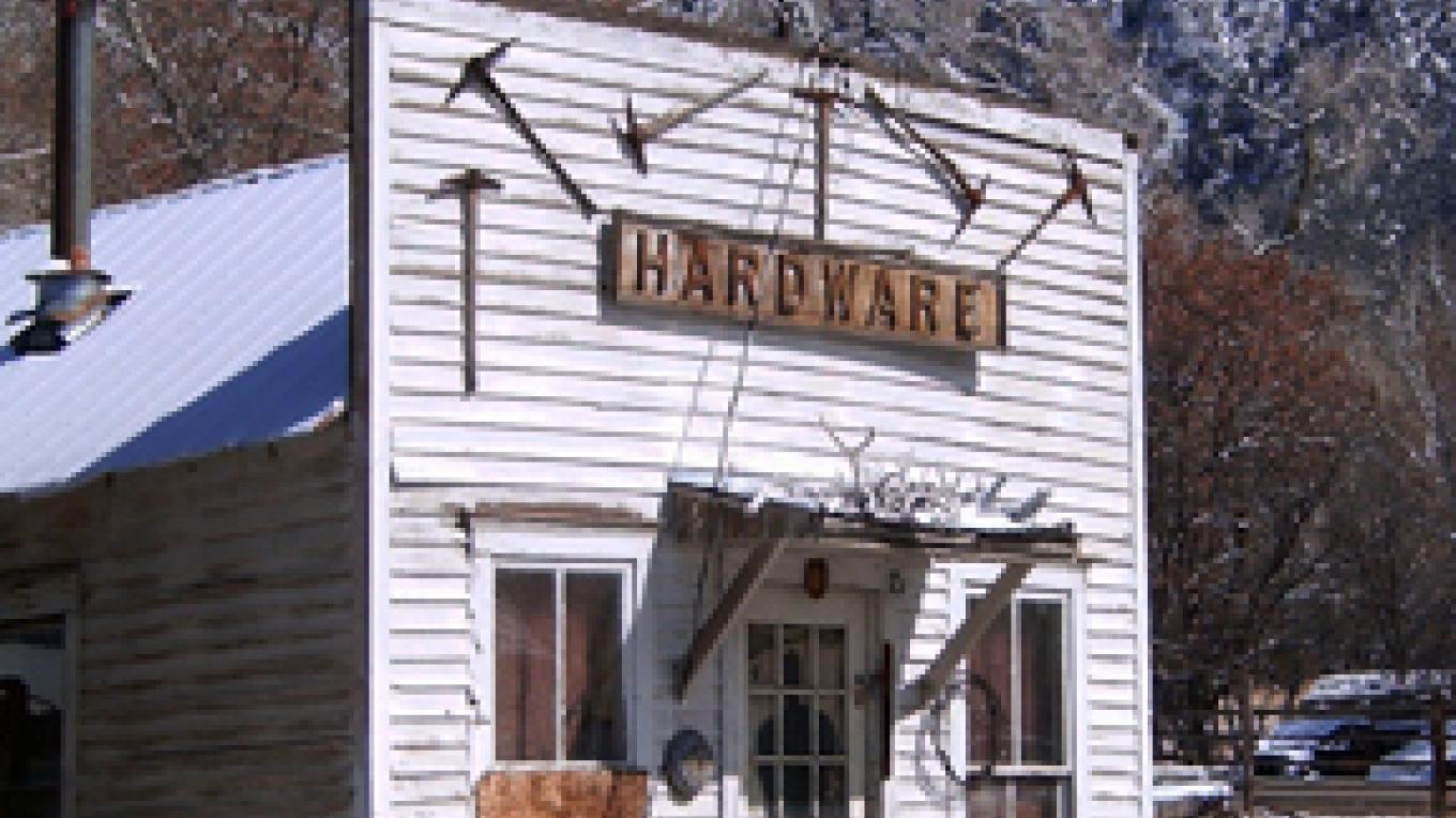 No longer in use, the old hardware store still stands, reminding us of our past. – Carmin