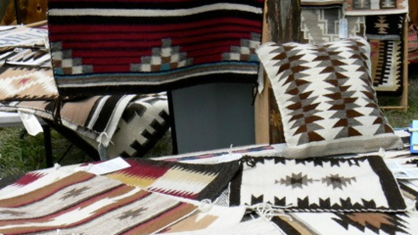 An assortment of beautiful weavings traditionally handcrafted by the Ramah Navajo Weavers Association at  the Ancient Way Arts Trail 2008 Spring Festival  at the Cimarron Rose Bed & Breakfast – Sheri McWethy Kennedy