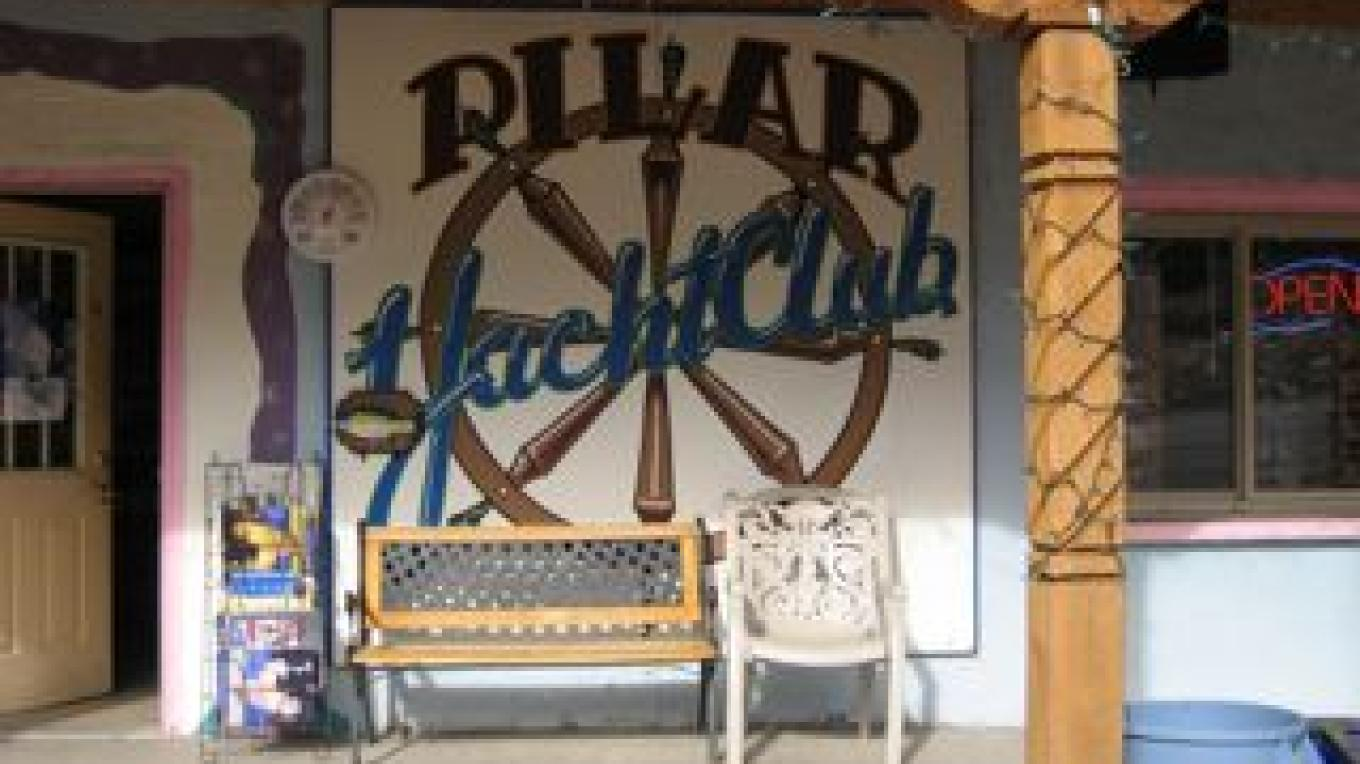 Pilar Yacht Club front porch with sign – Rico Salazar