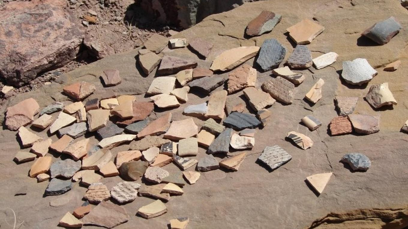 Abundant potsherds provide evidence the Hopi were here.  Touch and feel, but leave them here, please. – Ron Robinson, AAS