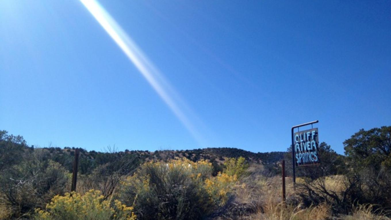 Our sign on State Highway 111 just south of the turn to El Rito. – H. Atterbury