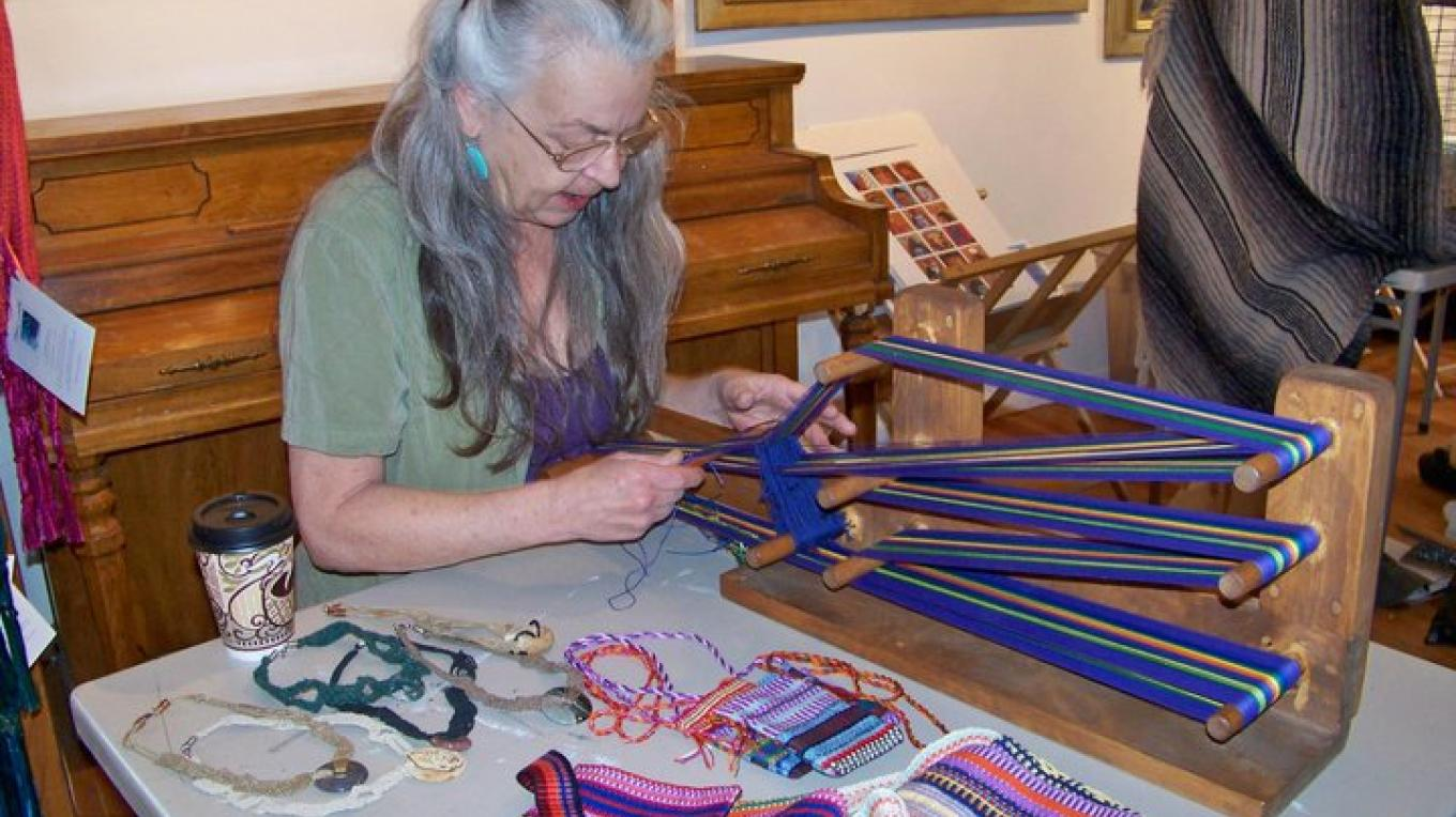 A member of the El Morro Traditional Crafters demonstrates a method of weaving at the Annual Fiber Festival – J. Rossignol