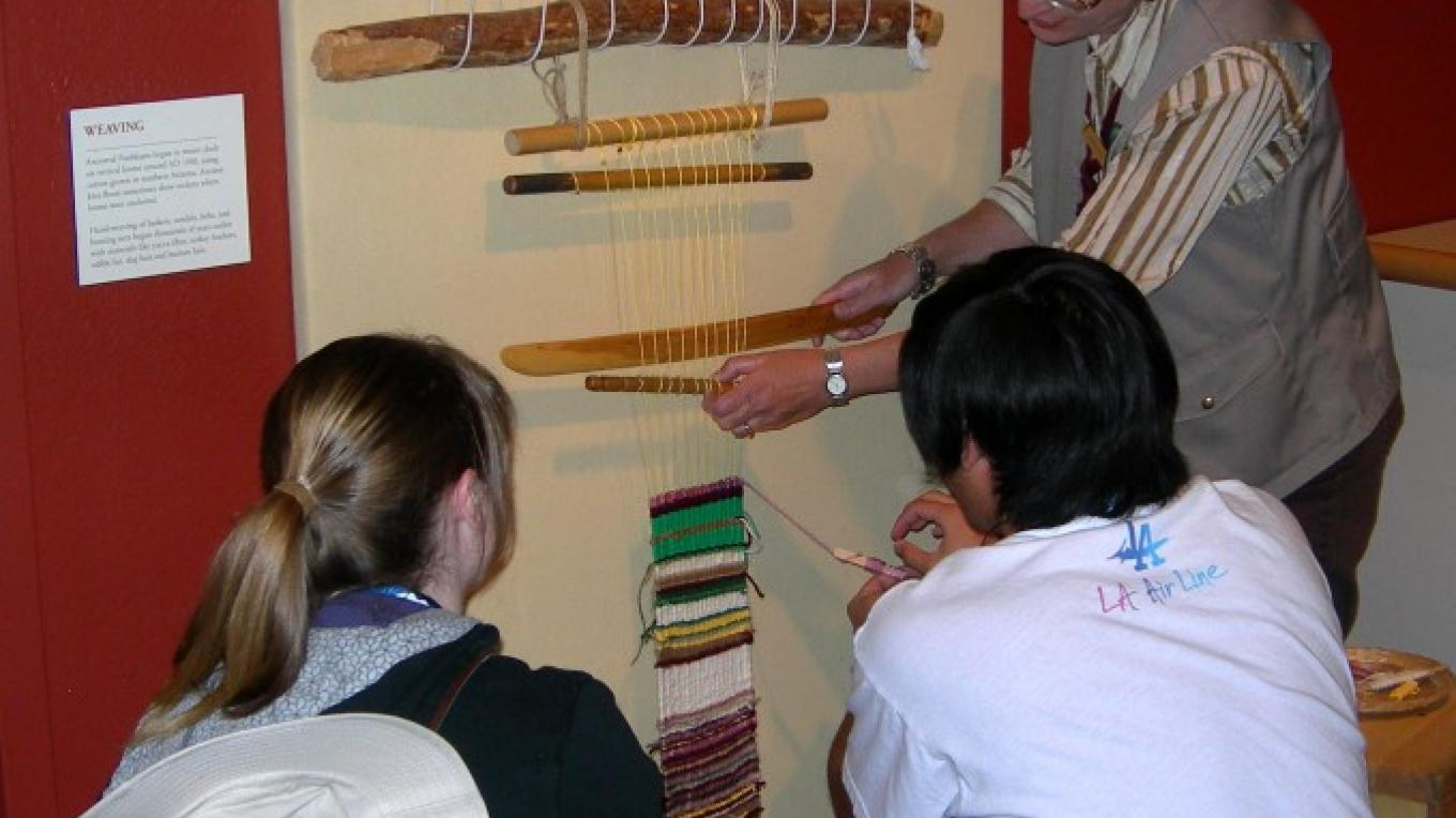 The Anasazi Heritage Center main gallery offers many hands on activities including traditional weaving on a loom. – Bureau of Land Management Anasazi Heritage Center