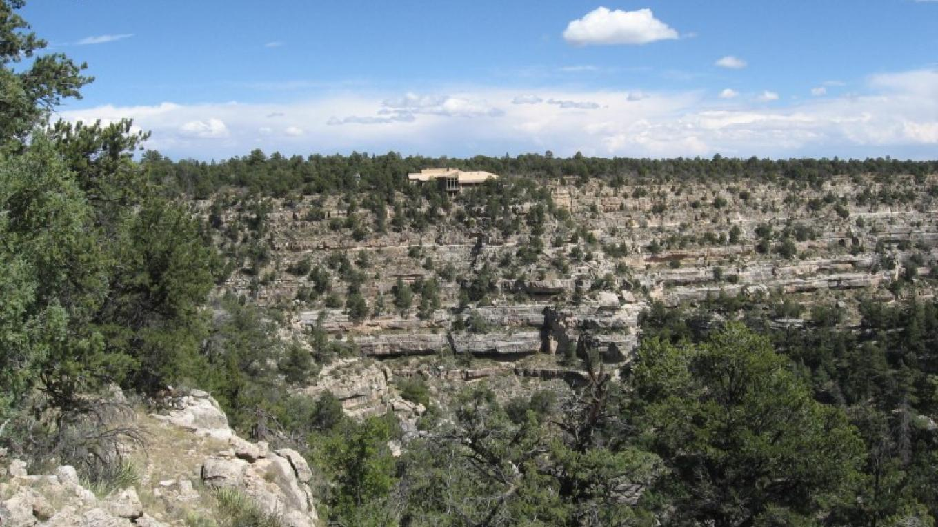 Walnut Canyon visitor center overlooks the canyon under azure skies – Walter Gossert