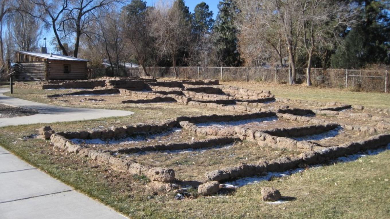 Puebloan Ancestor Dwelling ruins with Romero Cabin in the background – G. Strickfaden