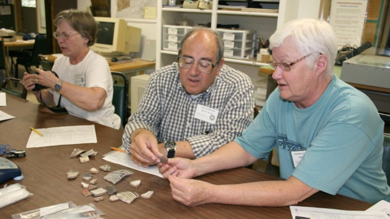 Participants in Crow Canyon's Archaeology Lab Program examine some of the thousands of artifacts that come through the Center's lab every year. – Canyon Archaeological Center