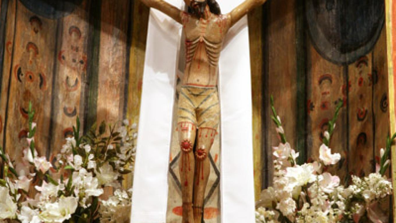 Cristo Crucificado, centerpiece of main altar. Created by Jose Raphael Aragon in mid 19th century. – Richard L. Rieckenberg