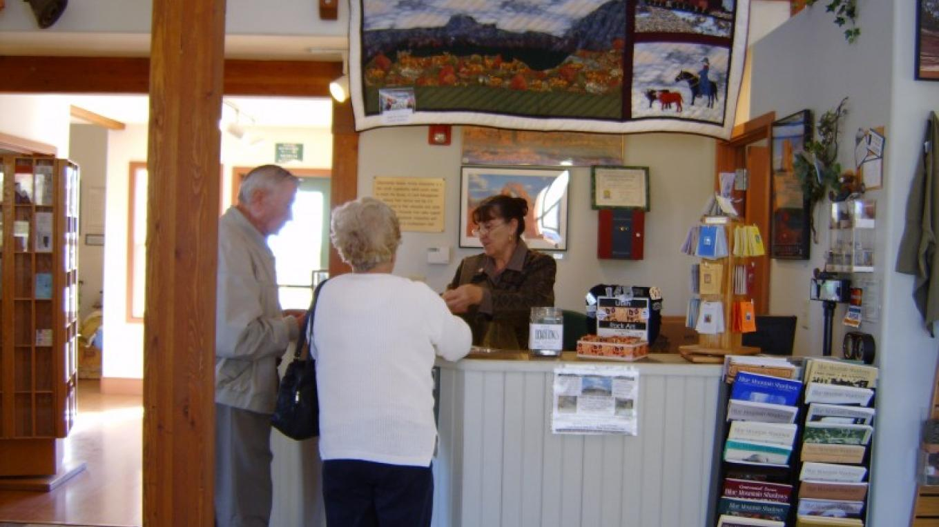 Staff assisting visitors at the Blanding Visitor Center – S. Taylor