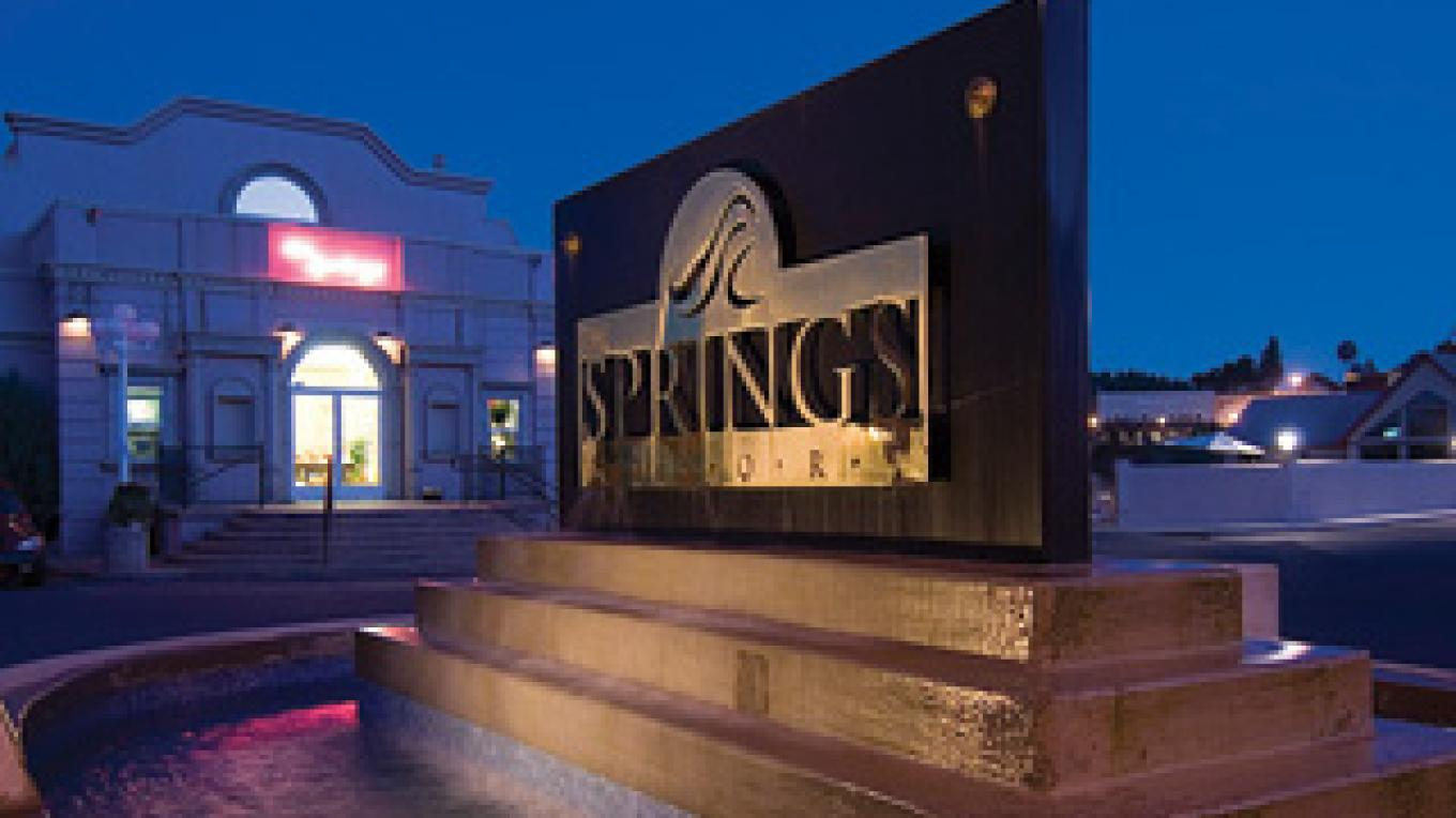 Evening settling in at the entrance of The Springs Resort and Spa. – The Springs Resort