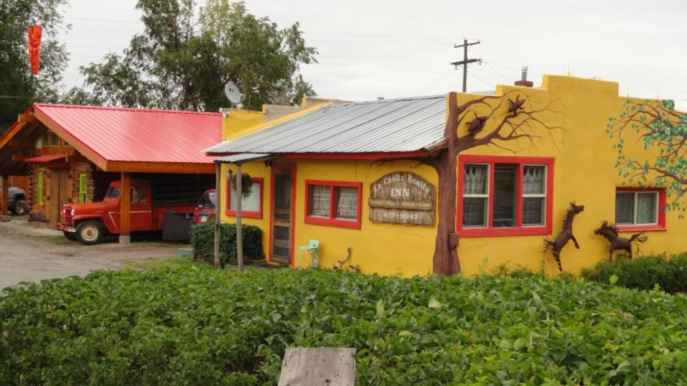 "The Divide Riders Hostel with the ""La Casita Bonita Inn"" in the for front – KimAnna Cellura-Shields"
