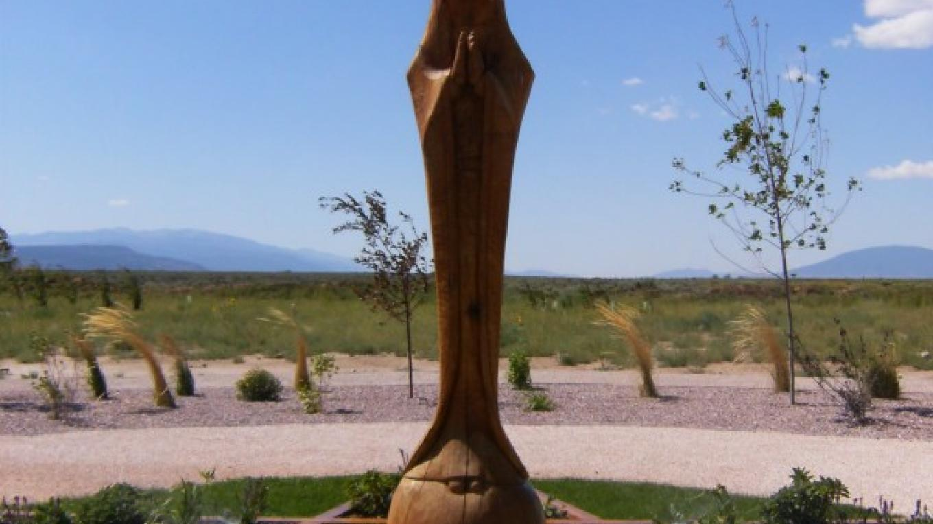 Totem carving of Mother Mary centered in the garden. – Susan Sanderford