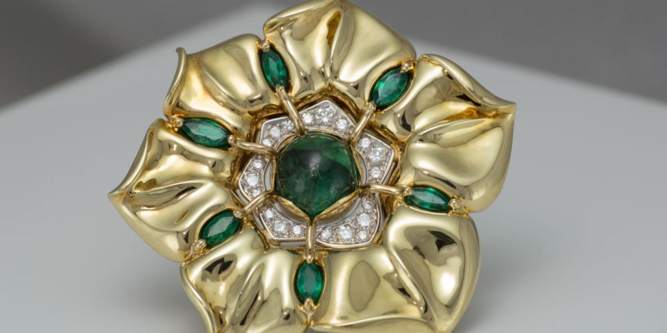 18k yellow gold and platinum combination pendant/broach/pearl-enhancer with Columbian centre trapiche' emerald, marquise cut Zambian emeralds and Russian diamonds. $25,000.00 – This beautiful one-of-a-kind creation is a worthwhile addition to your fine art jewelry collection.