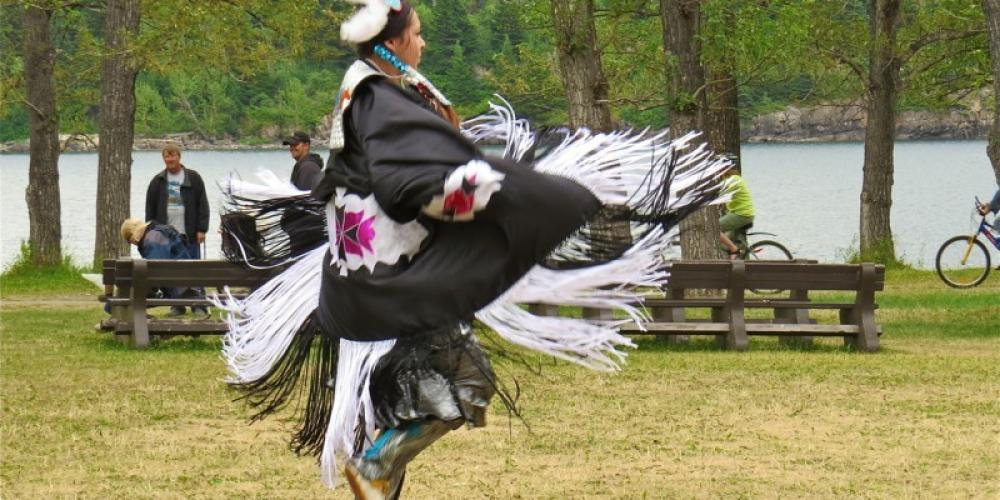 Blackfoot dancer demonstrates Fancy Shawl dancing on the green space beside the Heritage Centre – L. Anne McClelland