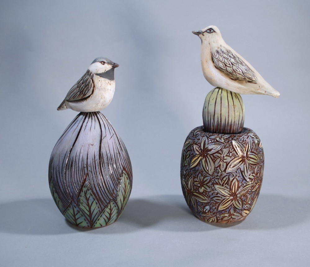 Ceramic animal sculptures, bird sculptures, and vessels with carvings.