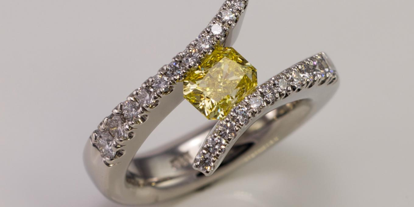 Natural yellow diamond set in diamond encrusted platinum tension ring. $45,000.00 Available by custom order – Beautiful timeless heirloom quality yellow diamond and platinum bespoke ring that will be cherished for generations.