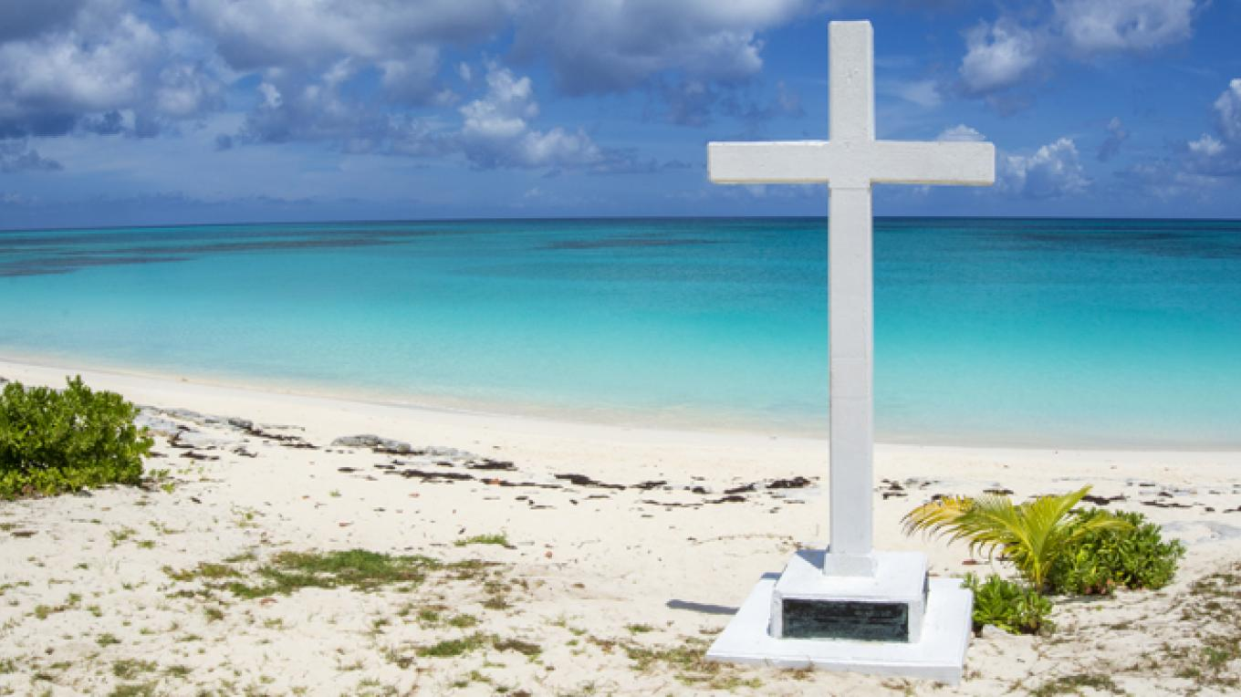 This simple white cross at 'Long Bay' commemorates the point where Christopher Columbus is believed to have come ashore, after anchoring his long boat. – Alex Mustard