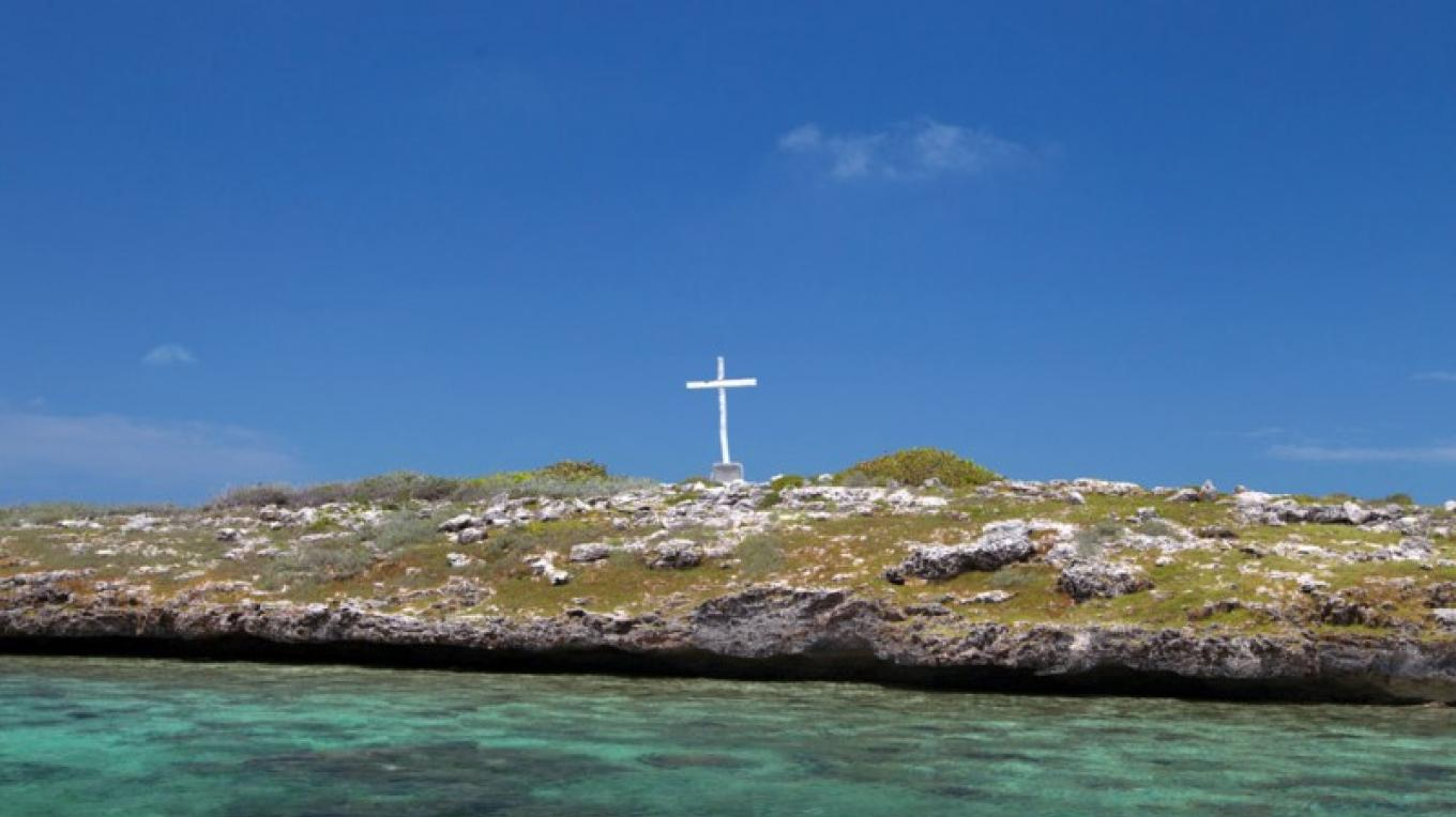 Pigeon Cay and the Memorial Cross from a distance. – Administrator's Office-Ragged Island