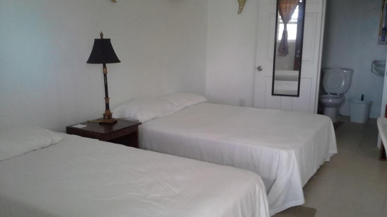 Sample bedroom at BrensVille Suites – BrensVille Suites