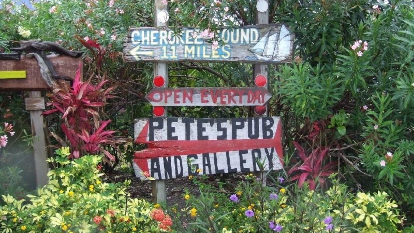 A sign pointing out the location of Pete's Pub & Gallery. – Heather Moore