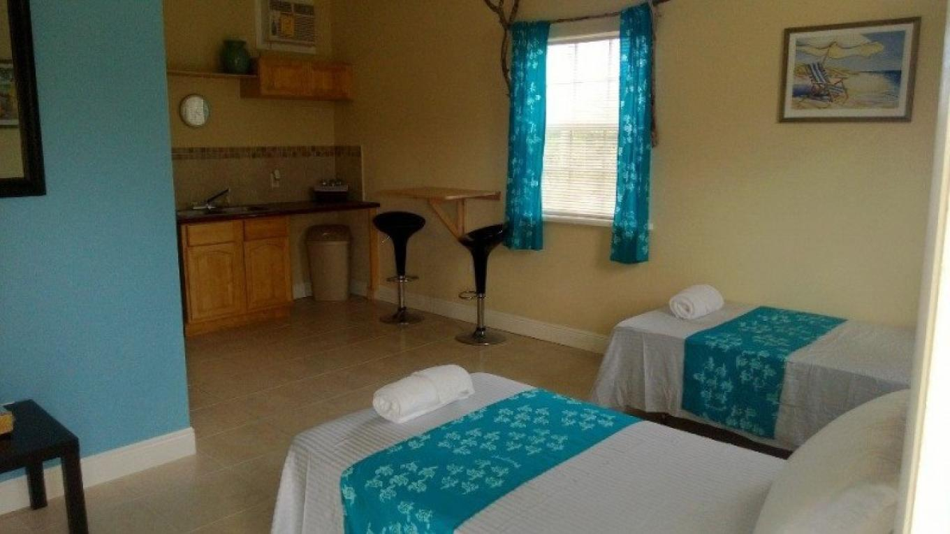 View of dining and sleeping areas in a room. – Rolle's Place