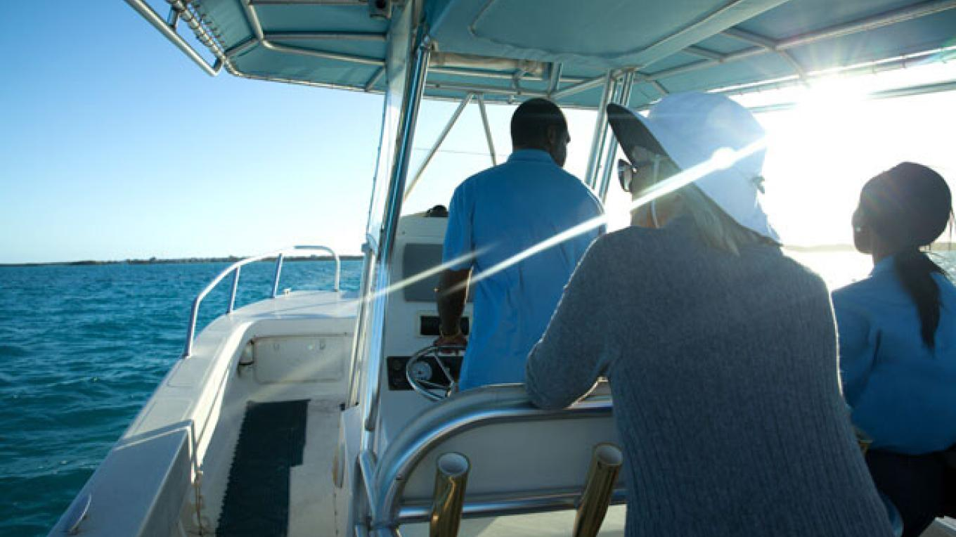 Guests taking our private boat to our island. – Lumina Point Resort & Spa