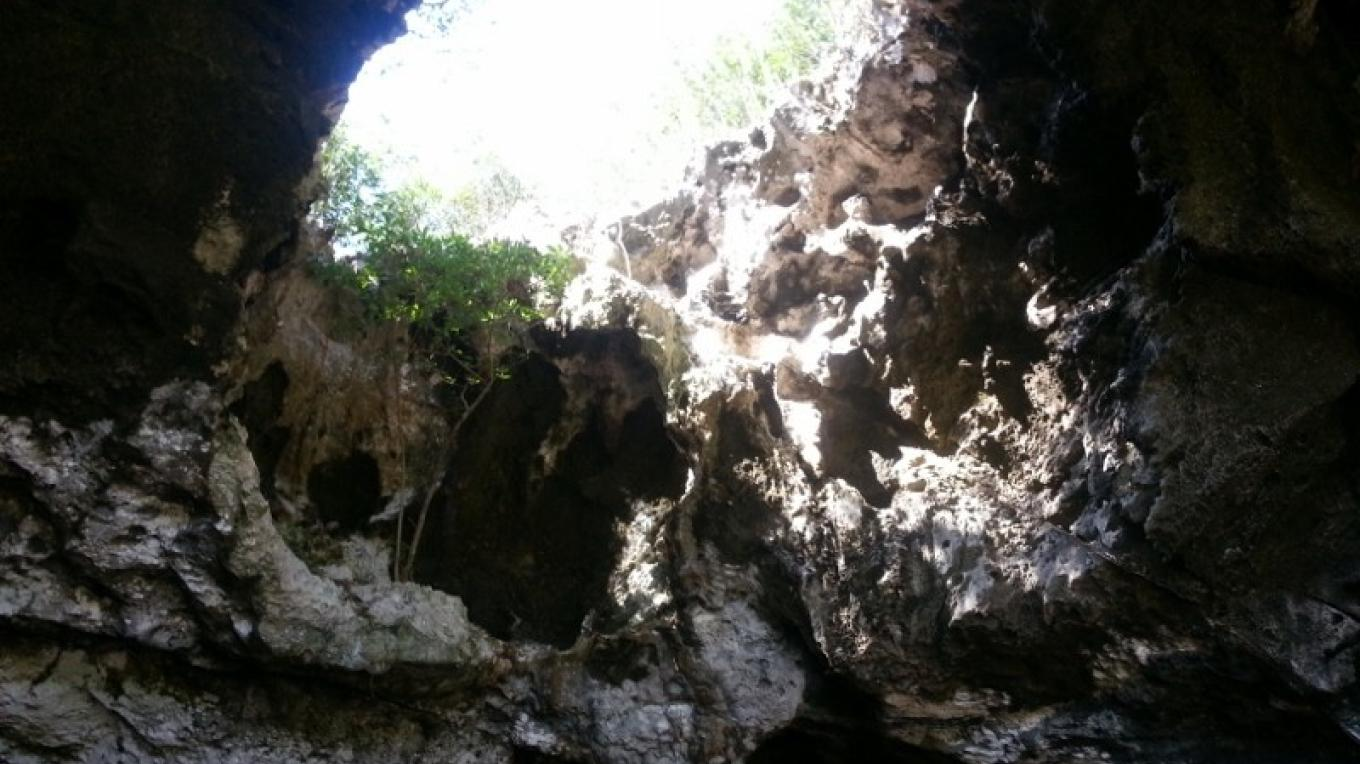 Sunlight comes through a large hole in the ceiling of Preacher's Cave. – Bahamas Ministry of Tourism
