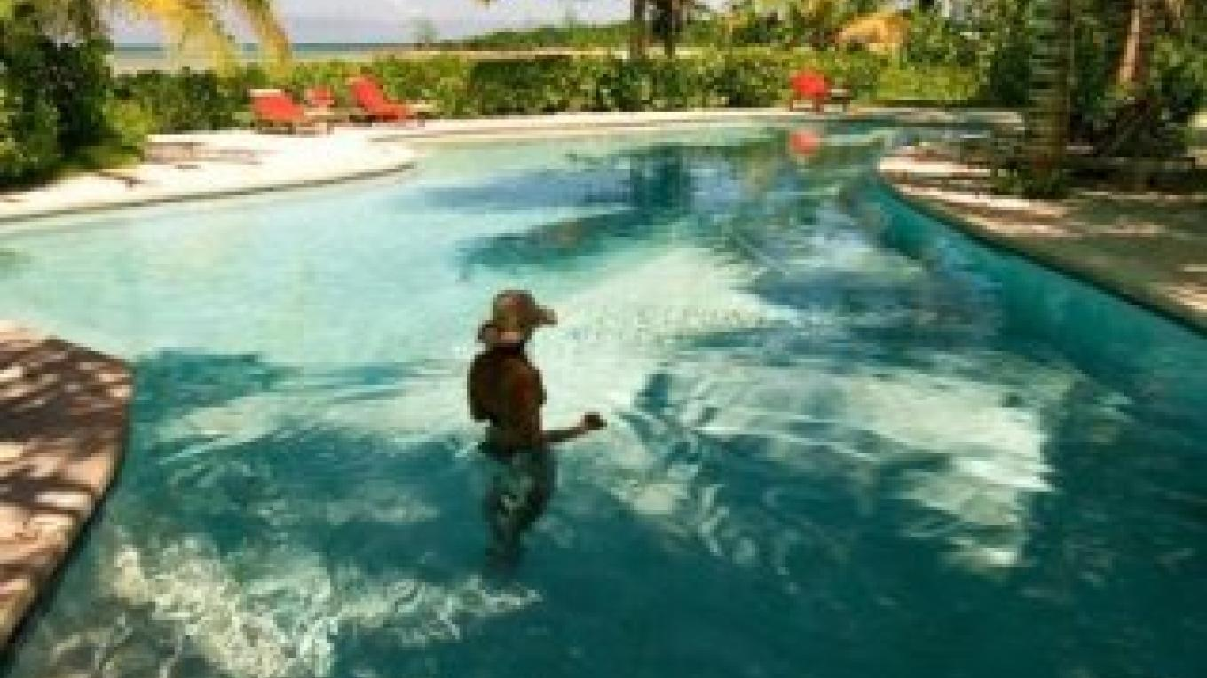 Photo of guest in pool. – Kamalame Cay Resort