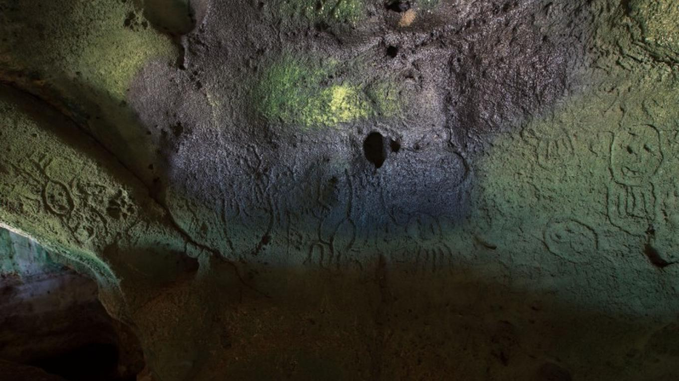 Petroglyphs on a wall inside Hartford Cave – Bahamas Ministry of Tourism