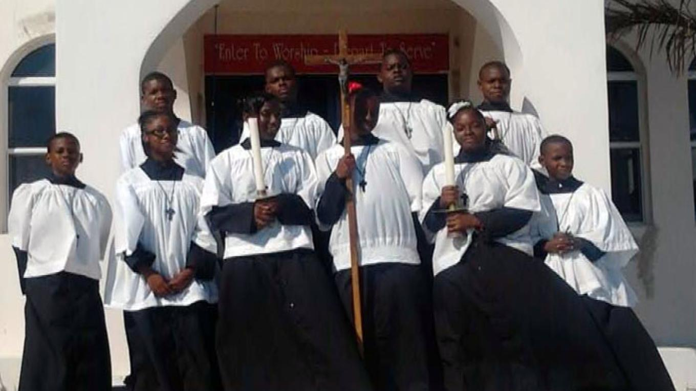 Altar persons stand in front of St. Bartholomew Church after a service. – Berry Islands Tourism Representative