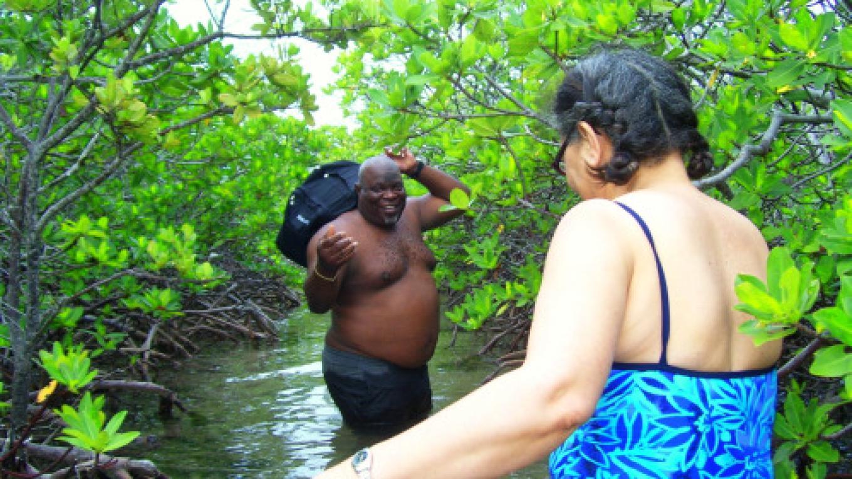 Ebbie helping a tourist in the Healing Hole – Bimini Bonefish Club