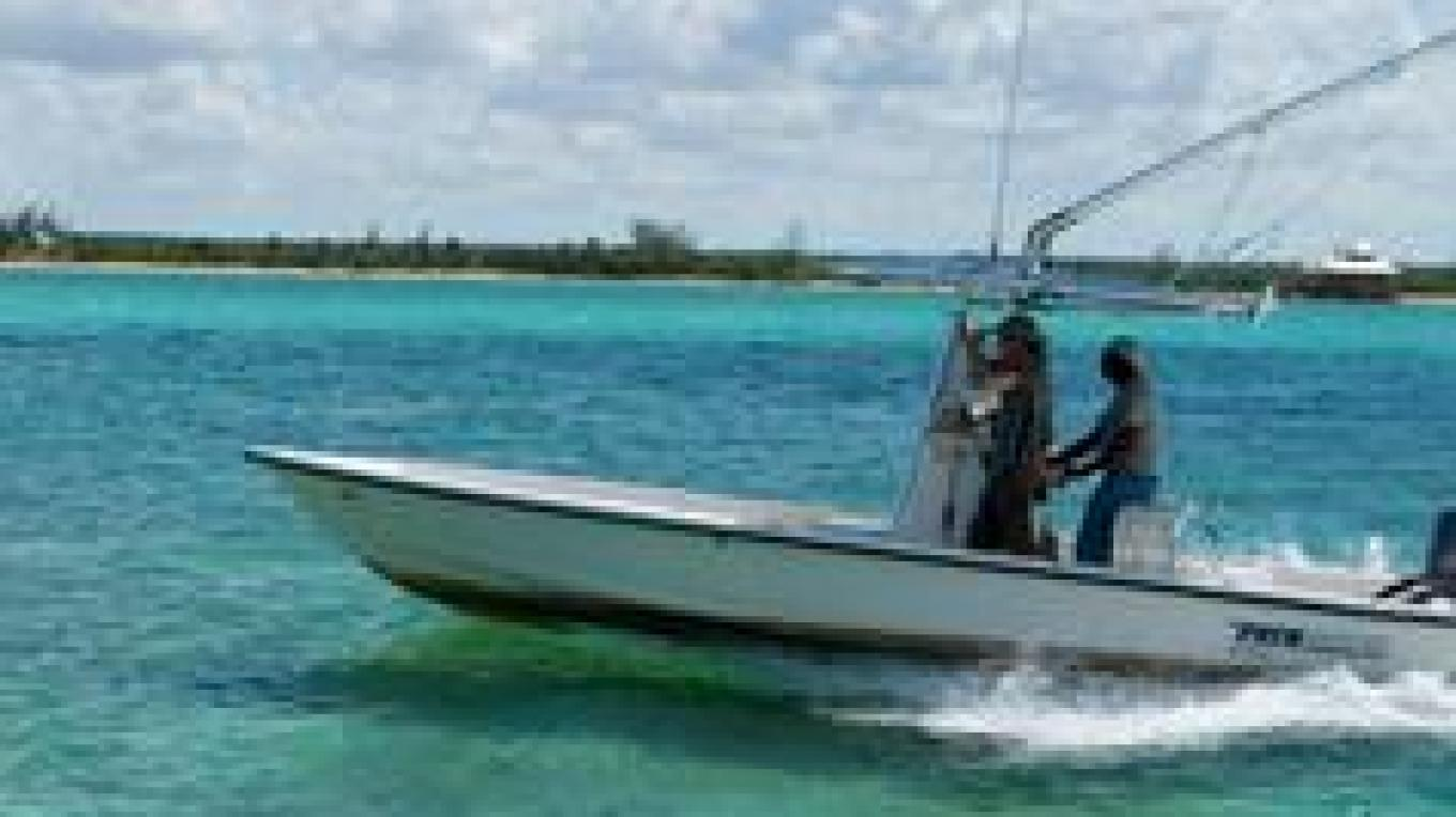 Photo of boat with men. – Bahamas Ministry of Tourism