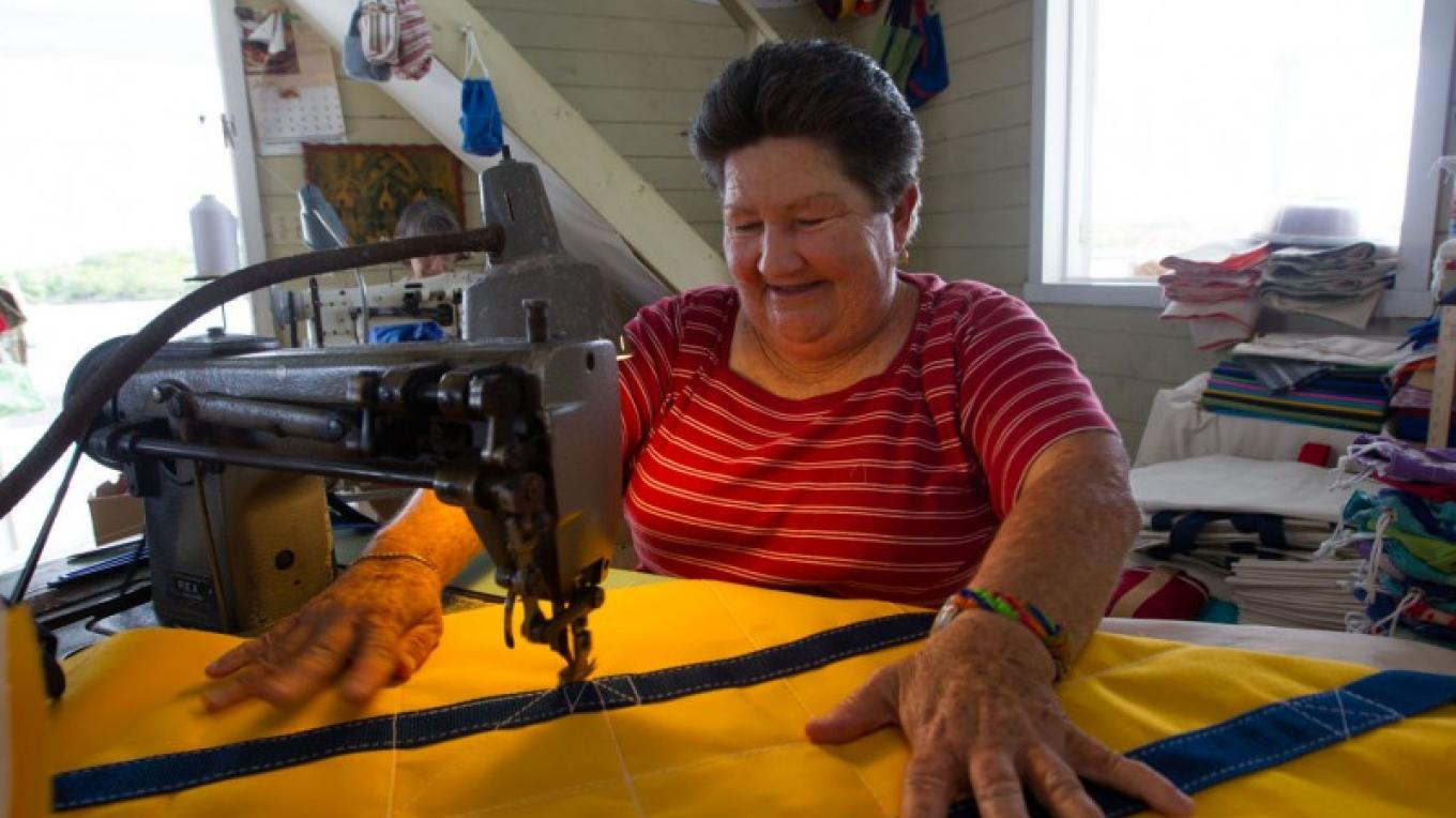 Woman creating items from Sailcloth at Albury's Sail Shop – Bahamas Ministry of Tourism